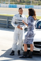 Torie Campbell and Lewis Hamilton chatting off camera during the pre season testing in Jerez.